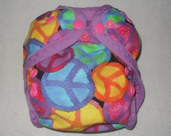 Multi colored peace signs one size AI2 snap diaper