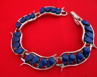 "Vintage 7.5"" silver bracelet with navy blue thermoset accents in great condition, appears unworn"