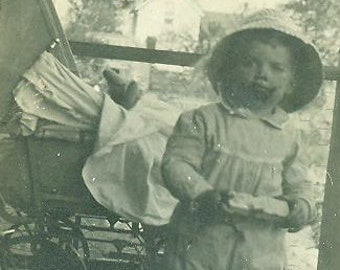 1912 Toddler Boy Eating Candy Antique Photo Standing on Front Porch Baby Buggy Behind Photograph