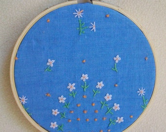 Embroidery hoop   Wall art   Re-imagined vintage embroidered hand towel   Sky blue linen   Embroidered  daisies