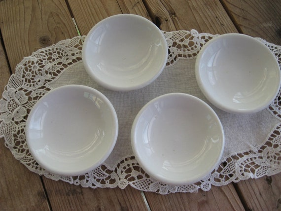 White ironstone butter pats marked set of four Maddock & Co.England