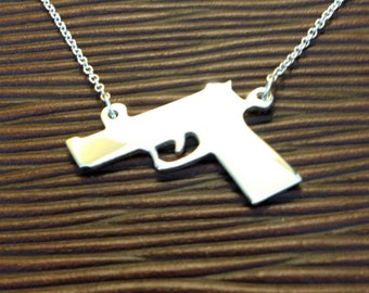 The Gold Gun Necklace