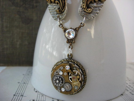 Antique Silver and Brass Steampunk Necklace - Vintage Watch Movement with rhinestones and Wings