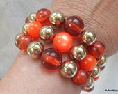Orange Moon Glow Bead Wrap Bracelet with Gold Metallic Beads And Clear Lucite