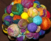 Vividly colored hand made ball of balls, needle felted in many colors all felted together, cup not included.