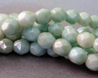 6mm Pale Green Star Dust Fire Polished Beads - Czech Glass