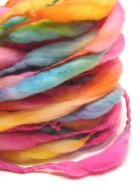 Handspun rainbow yarn, spun thick and thin in merino wool- 25 yards, 2.0 ounces/ 57 grams