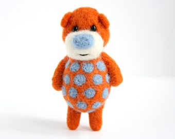 Vibrant orange bear with sky blue polka dots