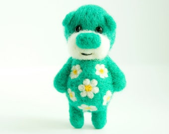 Green-ish, blue-ish bear with cammomiles