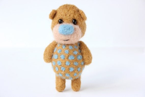 Light brown bear with blue polka dotts