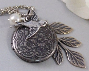 Peaceful Sparrow,Locket,Silver Locket,Bird,Wing,Branch,Twigg,Sparrow,Antique Locket,Steampunk. Handmade jewelry by valleygirldesigns.