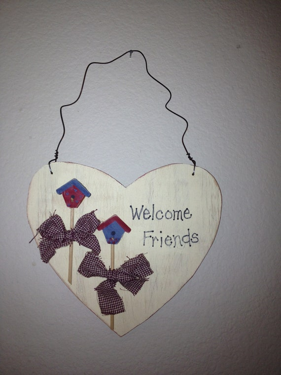 Welcome friends with mini birdhouses and a heart