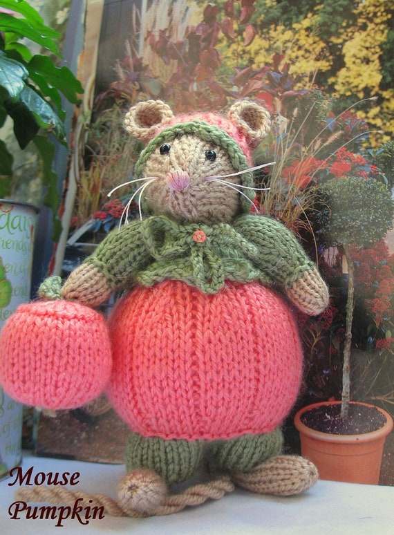 Too cute to save just for Halloween.  Handknitted Mouse who's name is PUMPKIN