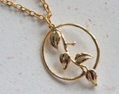 Golden Leaves with round frame necklace in gold color (N307)