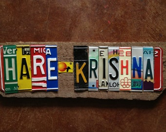 HARE KRISHNA hindu rama ganesh upcycled recycled art license plate sign on barn wood George Harrison tomboyART tomboy