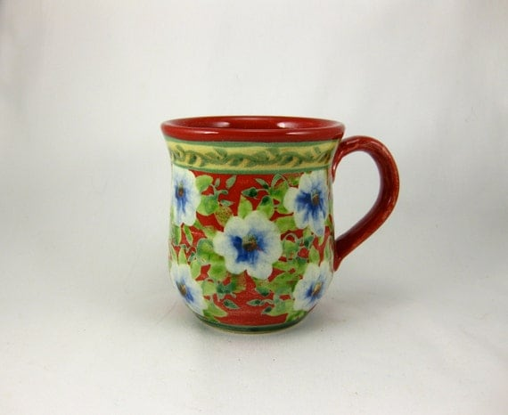 Red handmade and painted porcelain coffee cup