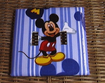 Disney Mickey Mouse Set Double Toggle Light Switch Plate Cover and 3 Outlet Set includes child safety plugs