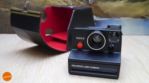 Black Polaroid 1000S camera