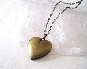 Heart Locket Necklace.antique brass heart locket in long chain.