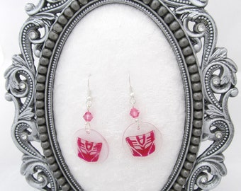 Pink Decepticon symbol earrings