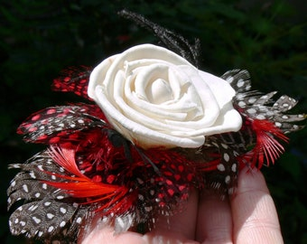 Feather Facinator with Sola wood rose and coordinating feathers in natural ivory, browns, blacks, and reds