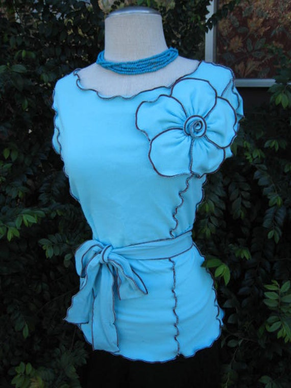 Aqua color sleeveless top with rose decoration and a belt for opitional plus made in USA