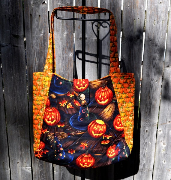 Jack o Lanterns, witch's hats and brooms print Halloween Quilted Hobo style handbag
