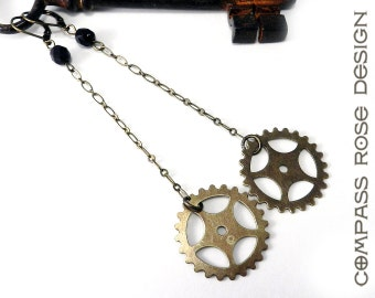 Steampunk Earring Brass Sprocket Antiqued Brass Long Dangle Gear Earrings with Black Accent handmade by Compass Rose Design