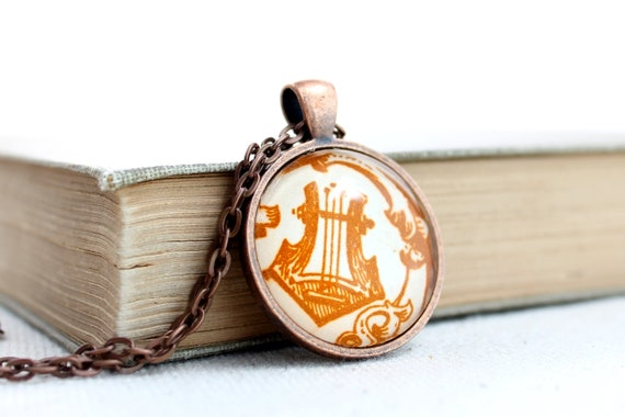 Lyre necklace harp jewelry made with vintage sheet music illustration in autumn colors glass and copper plated pendant