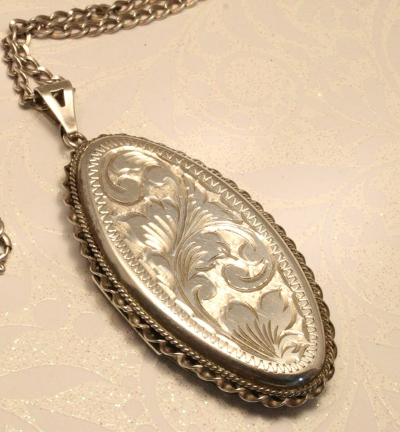 Vintage silver locket. Large. Oval shape. On silver chain
