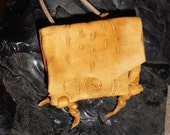 Rain- This Wisdom Pouch is made out of Lt. Gold colored Deer skin leather and features a continuous carving