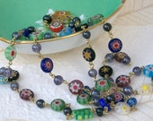 Long millefiori flower infinity necklace with Czech glass.