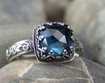 Deep Waters Ring - 8mm Cushion Rose Cut London Blue Topaz in Heart Crown Bezel with Swirled Band