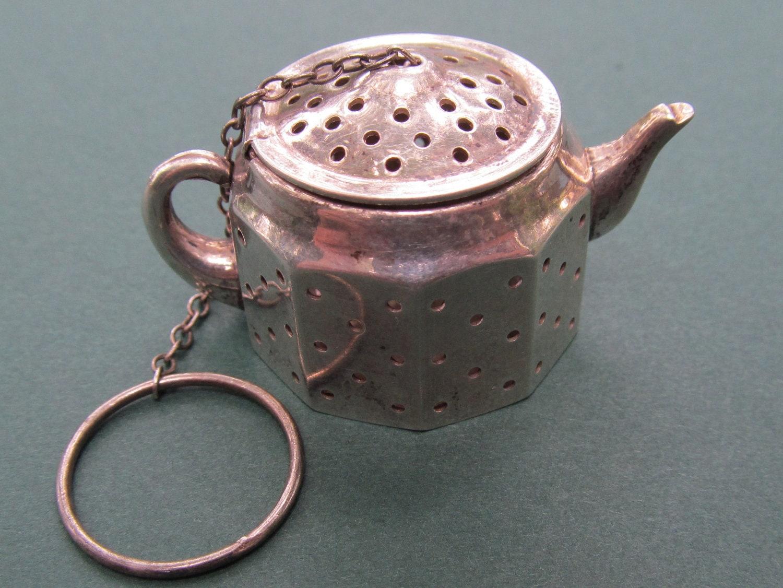 Antique sterling tea pot strainer by
