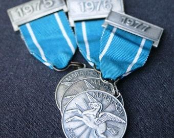 Seventies marathon. Souvenir medal trio.