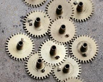 Vintage clock brass gears -- set of 12 -- D4