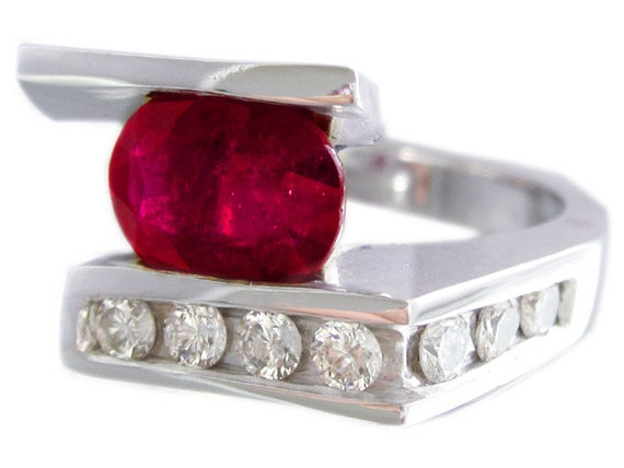 14k white gold oval ruby and diamonds semi tension set ring 4.02ctw