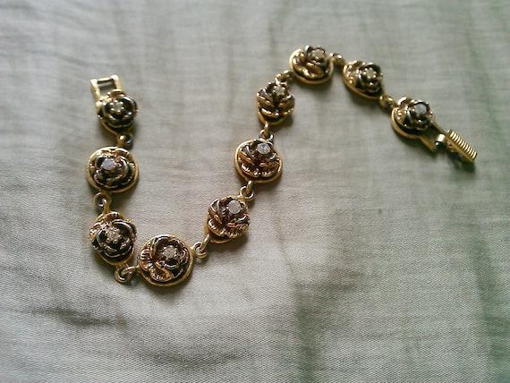 Vintage goldtone bracelet with rhinestones, signed Goldette NY
