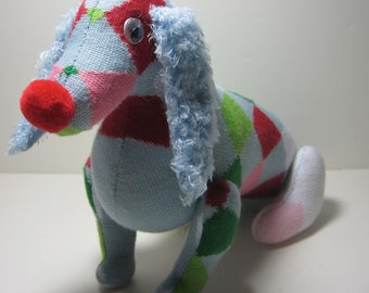 RUDOLPH A goofy red nosed recycled sock dog with a checkered past.