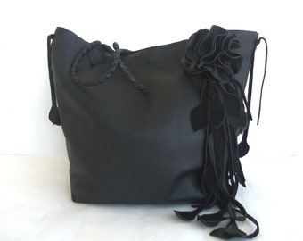 black leather tote with leaf fringe and flower by Tuscada. Made to order.