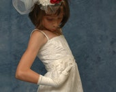 Vintage white lace flower girls dress in retro style. Beaded ivory sash on the white lace flower girl dress.