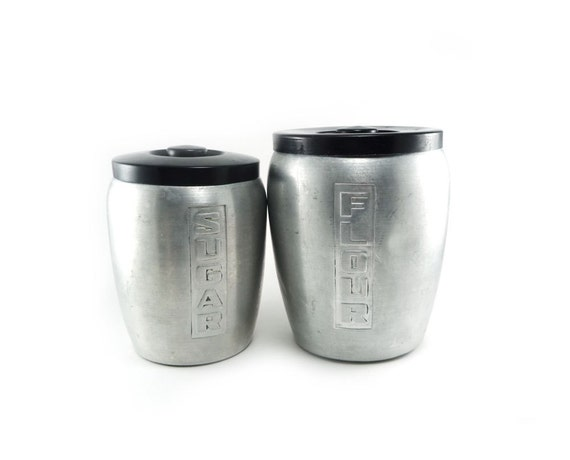 Vintage aluminum canisters - silver and black flour and sugar canisters