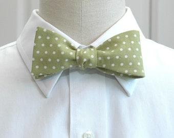 Men's bow tie in celery green with white polka dots (self-tie)