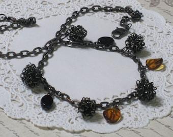 Antique Spiral Charm Necklace - Antique Metal Spirals, Black and Topaz Charms On Gunmetal Chain - Sale