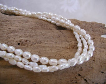 Triple Strand Necklace of White Freshwater Pearls