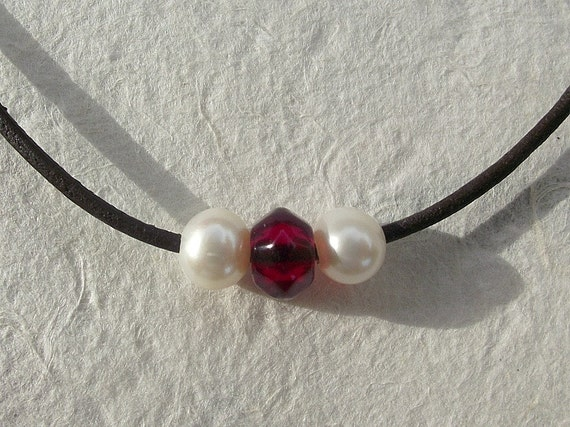 SALE. Pearl and red crystal necklace. Rich dark leather and simple freshwater pearls. Sparkly red crystal