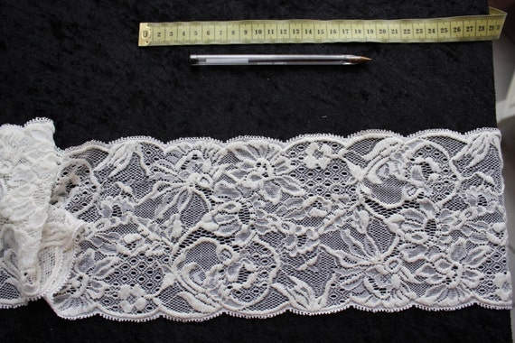 5.6 inches wide per 7yards  long ivory stretch french lace trim