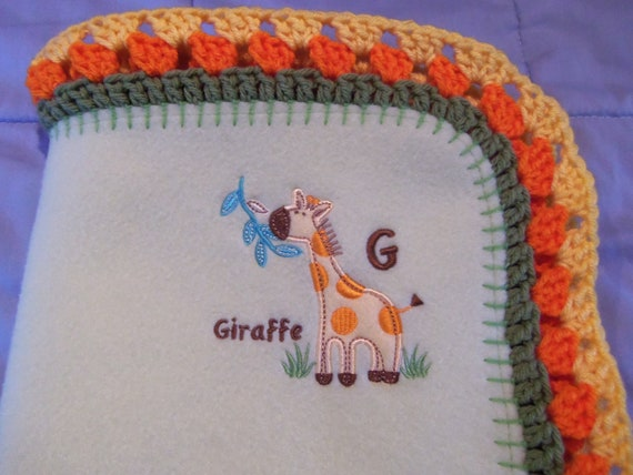 Adorable light green fleece blanket with embroidered giraffe and crocheted edge 33 x 43