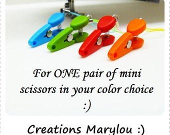 One pair of mini scissors. Perfect for knitting bag.