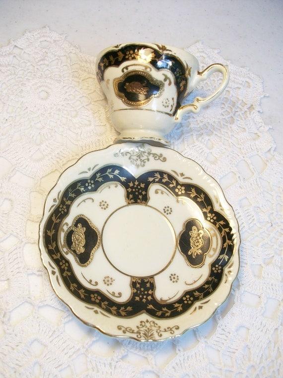 Gold Black Ivory Pedestal Tea Cup and Saucer Demitasse Ucagco /